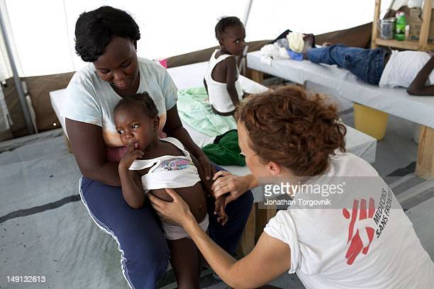 MSF doctor attending to Cholera victims at a MSF hospital on January 2011 in Sarthe a suburb in the north of PortauPrince The cholera outbreak...