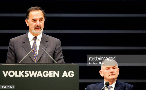 Doctor Bernd Pischetsrieder CEO of Volkswagen talks at the start of the 45th annual general meeting of Volkswagen AG as Ferdinand K Piech former CEO...