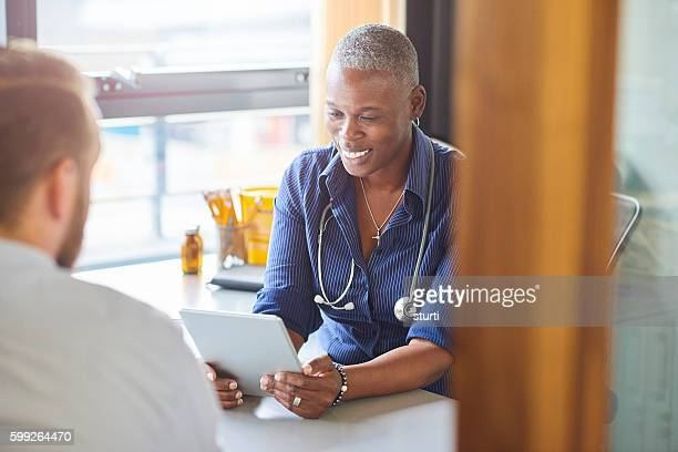 Doctor chatting to patient