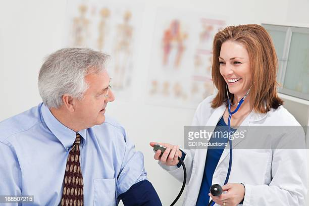 Doctor Checking Blood Pressure of a Mature Man
