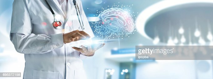Doctor checking brain testing result with computer interface, innovative technology in science and medicine concept : Stock Photo