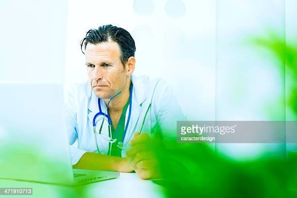 Doctor checking laptop in the hospital