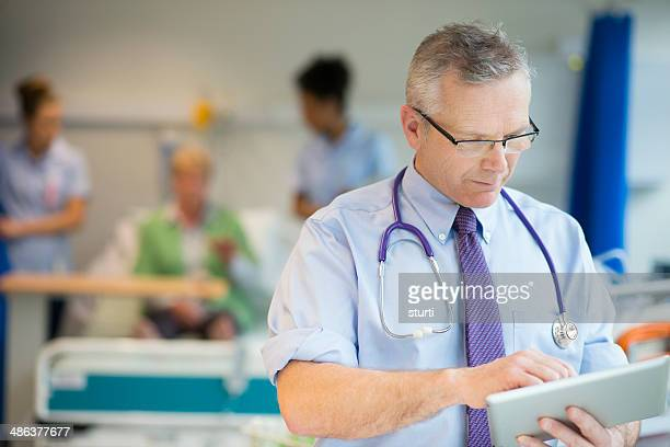 doctor checking notes