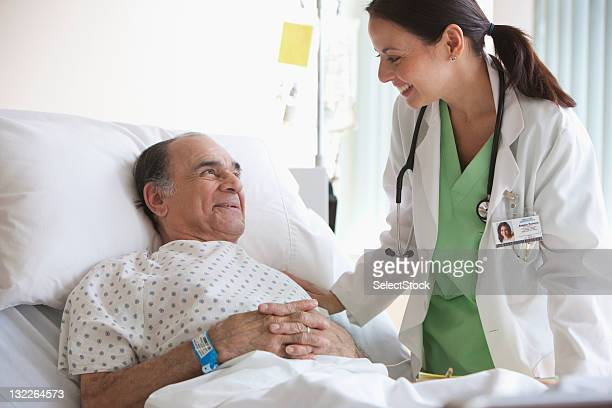 Doctor checking on older man
