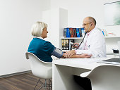 doctor checking patient`s blood pressure