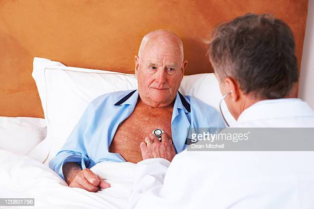 Doctor Checking the Heart of a Senior Man