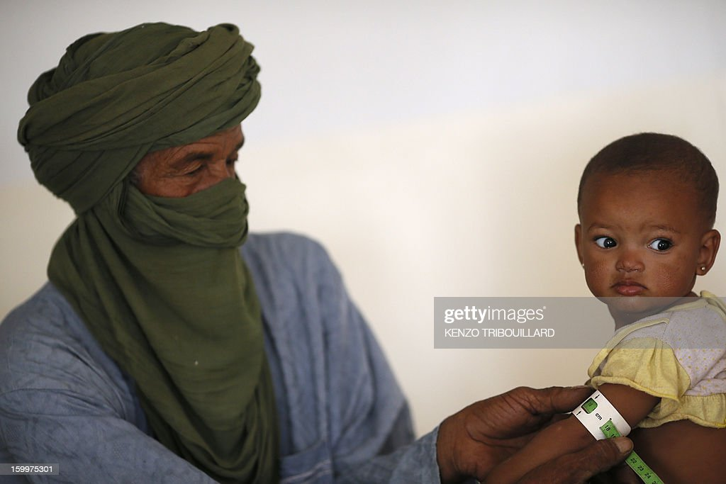 A doctor checks a Malian child, on January 24, 2013 at a refugee camp set in Menteao near the Malian border. The conflict in Mali has caused nearly 150,000 people to flee the country, while about another 230,000 are internally displaced, the UN humanitarian agency said on January 15, 2013. According to OCHA, the UN High Commissioner for Refugees has registered 144,500 refugees in neighbouring countries -- 54,100 in Mauritania, 50,000 in Niger, 38,800 in Burkina Faso and 1,500 in Algeria.