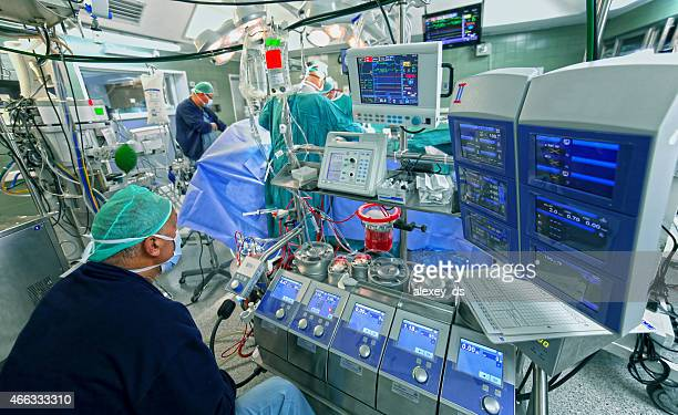 Doctor checks data of cardiopulmonary bypass machine