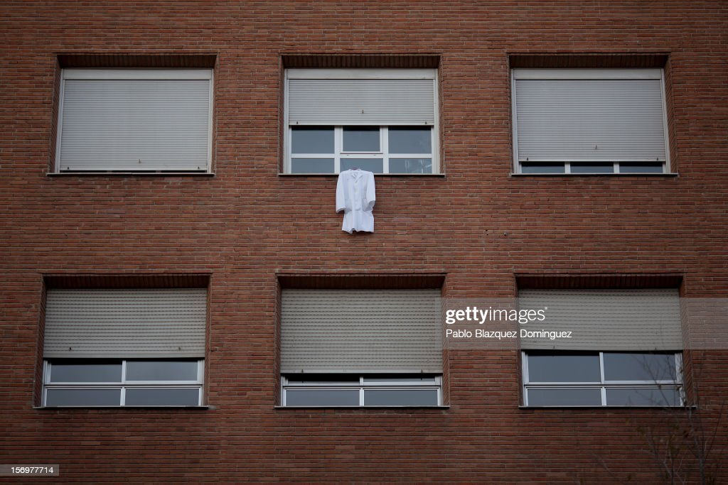 A doctor coat is hanged from a window of La Princesa Hospital on November 26, 2012 in Madrid, Spain. Trade unions for the first time have called for a 48 hour health worker's general strike in the Madrid Region after Regional Government announced severe cuts and privatization of Medical Centers.