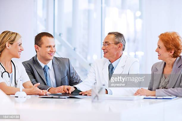 Doctor Collaborating with a Business Team