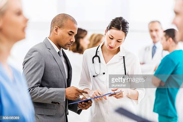 Doctor collaborating with a businessman.