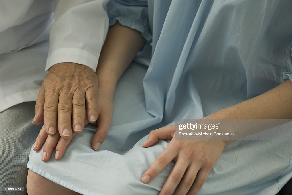 Doctor comforting patient, close-up