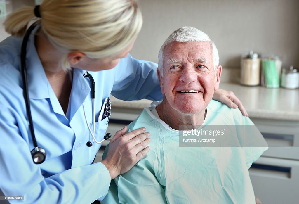 Doctor comforts patient. : Stock Photo