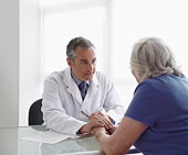 Doctor Consoling Elderly Patient