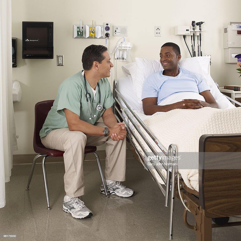 Doctor consultants with patient