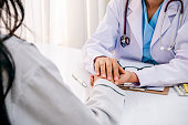 close up of doctor consulting and cheering patient