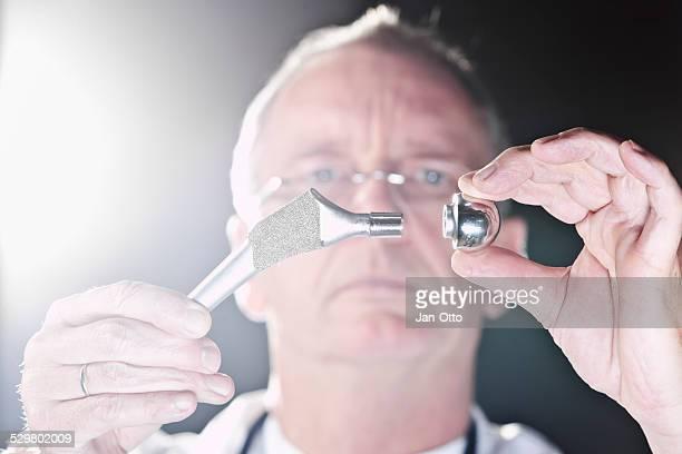 Doctor demonstrating total hip endoprothesis