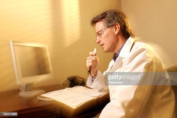 Doctor dictating at desk
