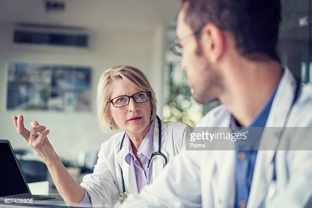 Doctor discussing with male colleague in hospital
