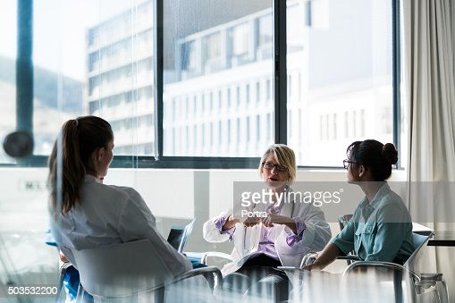 Doctor discussing with team in hospital