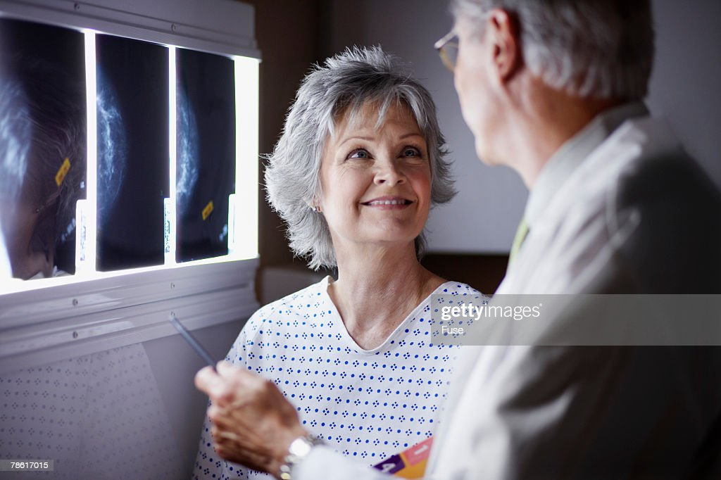 Doctor Discussing X-Rays with Middle Aged Woman