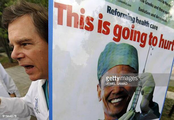 A doctor displays a placard as he takes part in a rally in Washington DC on October 1 2009 to voice disapproval of the current health care bills in...