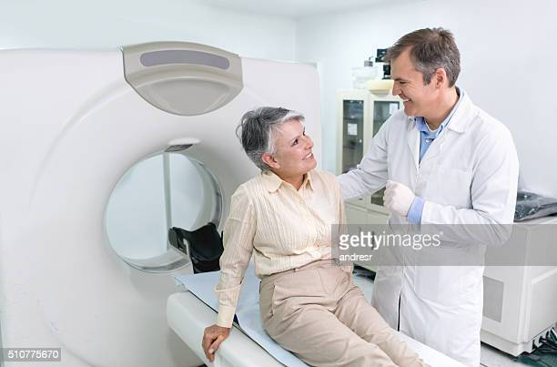 Doctor doing a CAT scan on a senior woman