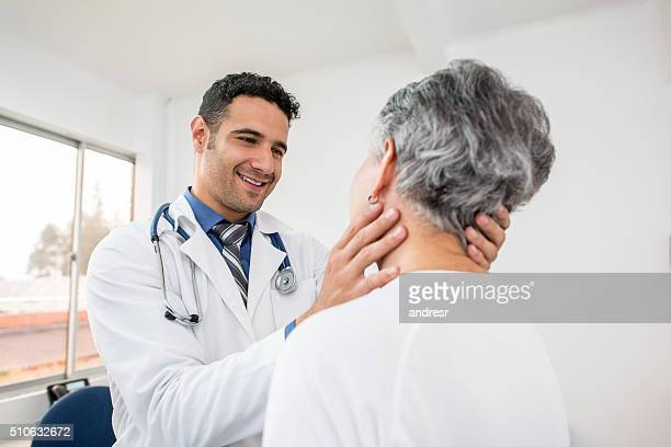 Doctor doing a medical exam on a senior patient