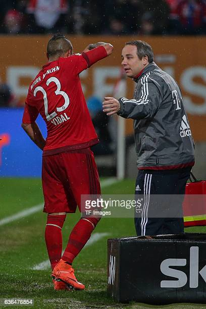 Doctor Dr Volker Braun of Bayern Muenchen give instructions to Arturo Vidal of Bayern Muenchen during the Bundesliga match between FC Augsburg and FC...