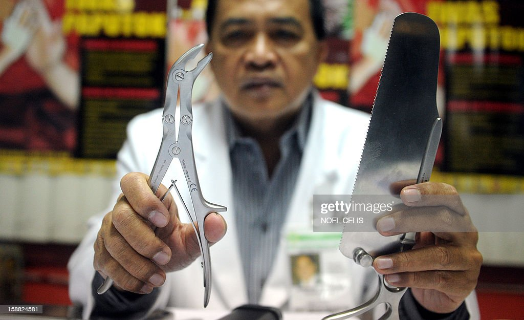 Doctor Emmanuel Bueno displays surgical tools used by doctors when operating on firecracker victims who are rushed to hospitals during the new year celebrations, at the East Avenue Medical Center in Manila on December 31, 2012. The Philippines braced on December 30 for its annual orgy of New Year's Eve merrymaking which every year leaves hundreds maimed by firecrackers or hit by bullets fired in the air by armed revellers.