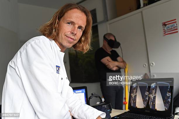 Doctor Eric Malbos poses during a therapy session with a patient wearing a virtual reality headset to help confront his phobias on October 8 2015 in...