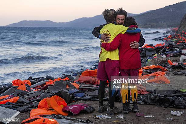 Doctor Essam Daod from Haifa Israel cries getting comforted by Proactiva lifeguards from Spain on Lesbos Greece on October 30 2015 The emergency team...