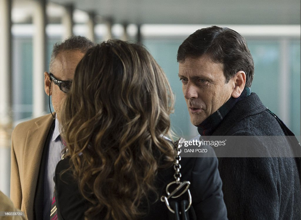 Doctor Eufemiano Fuentes (R) arrives at a court house in Madrid on January 28, 2013. Fuentes, accused of masterminding a vast doping network that rocked the sporting world and snared top cyclists went on trial along with four alleged conspirators. The case centres on a sophisticated network which was blown wide open on May 23, 2006 when Spanish police seized around 200 bags of blood in an investigation dubbed 'Operation Puerto'.