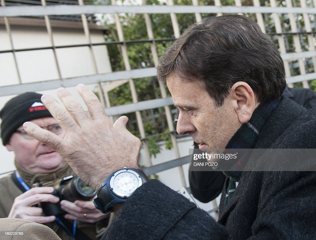 Doctor Eufemiano Fuentes arrives at a court house in Madrid on January 28, 2013. Fuentes, accused of masterminding a vast doping network that rocked the sporting world and snared top cyclists went on trial along with four alleged conspirators. The case centres on a sophisticated network which was blown wide open on May 23, 2006 when Spanish police seized around 200 bags of blood in an investigation dubbed 'Operation Puerto'. AFP PHOTO/ DANI POZO