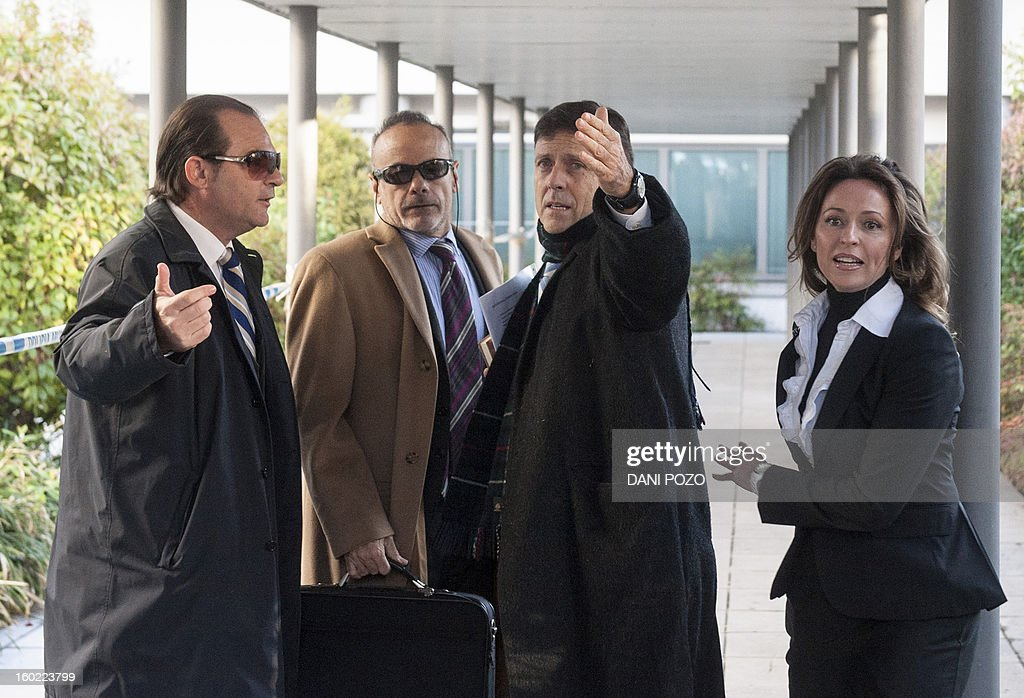 Doctor Eufemiano Fuentes (2R) arrives at a court house in Madrid on January 28, 2013. Fuentes, accused of masterminding a vast doping network that rocked the sporting world and snared top cyclists went on trial along with four alleged conspirators. The case centres on a sophisticated network which was blown wide open on May 23, 2006 when Spanish police seized around 200 bags of blood in an investigation dubbed 'Operation Puerto'.