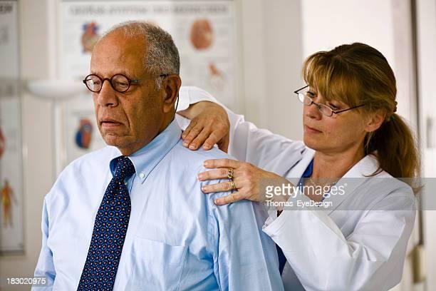 Doctor Examines the Shoulder of Her Patient