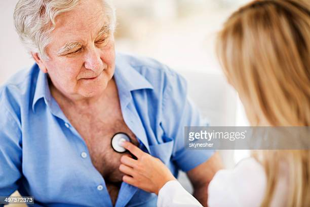 Doctor examining a senior patient.