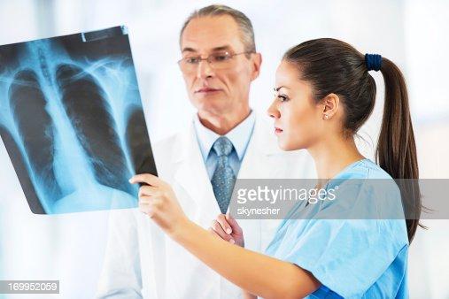 Doctor examining an x-ray image.