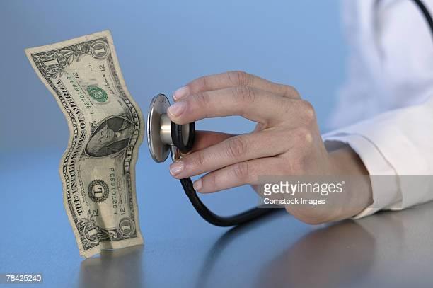 Doctor examining dollar bill