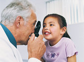 Doctor Examining Girl's Sight with a Strabismoscope
