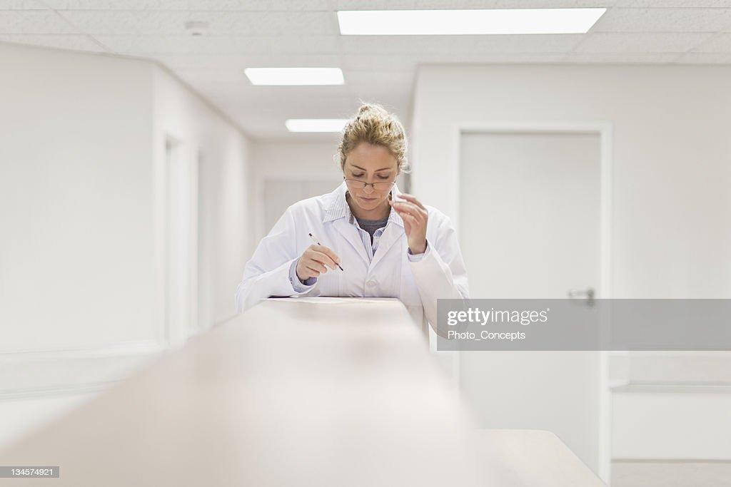 Doctor examining paperwork in hospital