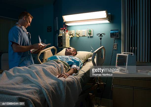 Doctor examining patient in hospital room