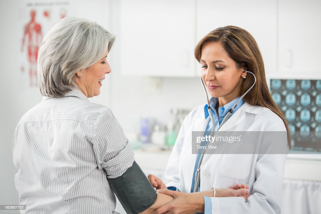 Doctor examining patient in office