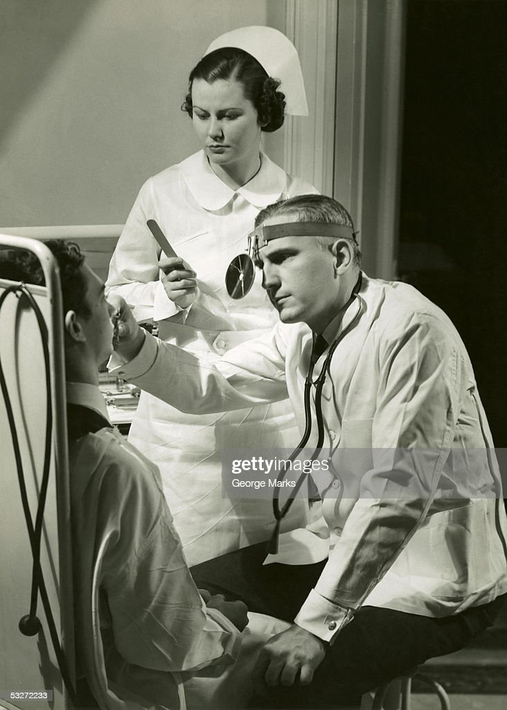 Doctor examining patient : Stock Photo