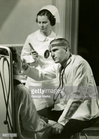 Doctor examining patient : Stock Photo