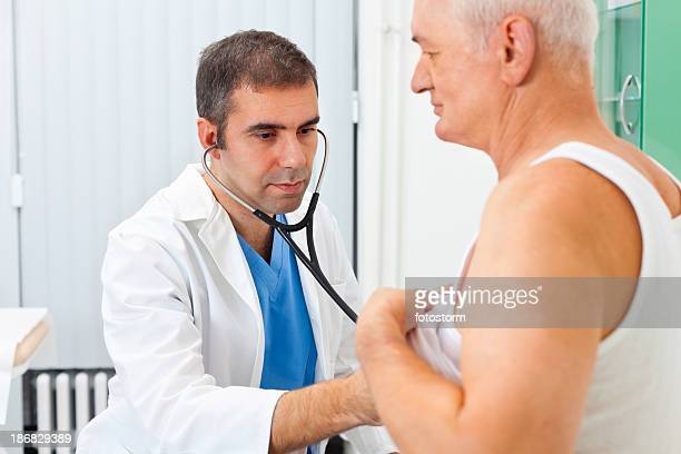 Doctor examining patient with stethoscope