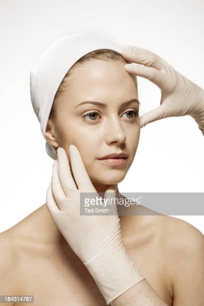 Doctor examining woman's face