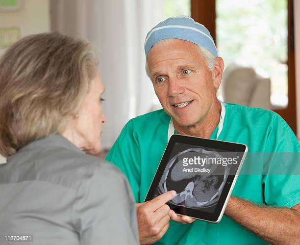 Doctor explaining medical cross-section to patient