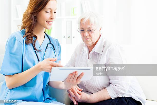 Doctor Explaining Medical Exam Results to senior patient.