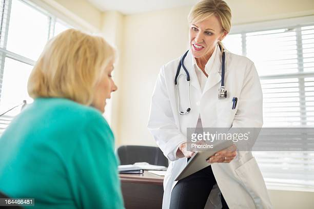 Doctor Explaining Medical Exam Results To Senior Woman